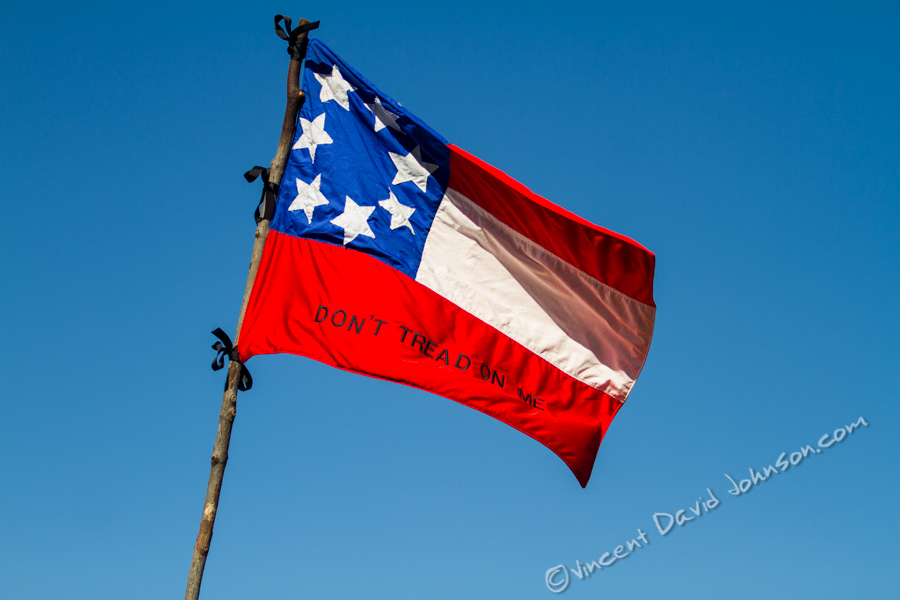 VINCENT D. JOHNSON - For Shaw Media The first version of the Confederate Flag flaps in the wind as it hangs over the artillery division during the Civil War reenactment at Dollinger Family Farm in Channahon, Oct. 17, 2015.
