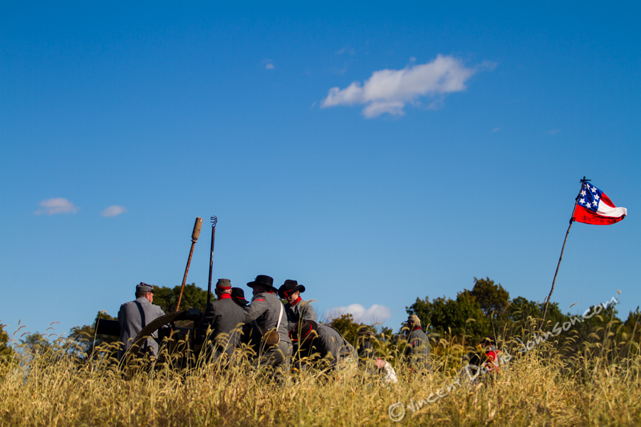VINCENT D. JOHNSON - For Shaw Media Confederate reenactors at one of the cannons wait, as a battle reenactment is about to get under way, Oct. 17, 2015. The event took place in one of the fields at Dollinger Family Farm in Channahon.