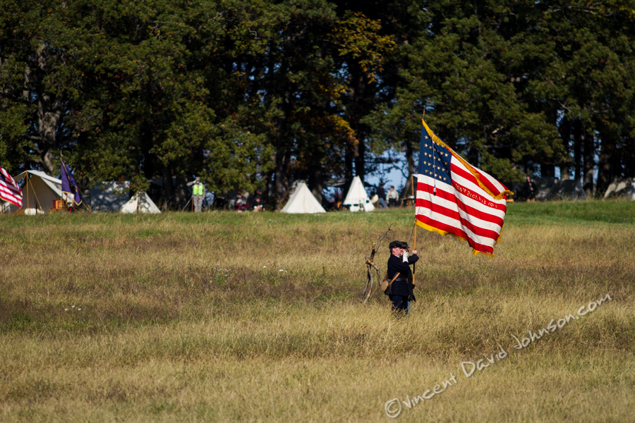 VINCENT D. JOHNSON - For Shaw Media The flag of the United State of America is presented at the beginning of the Civil War reenactment as all participants & viewers recite the Pledge of Allegiance, Oct. 17, 2015.