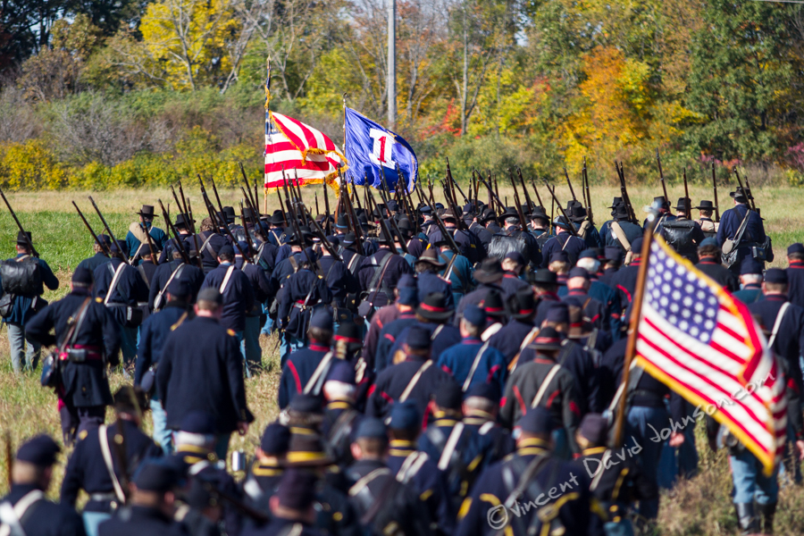 VINCENT D. JOHNSON - For Shaw Media Union Army reenactors march towards their starting position, as a Civil War battle reenactment is about to get underway at Dollinger Family Farm, Oct. 17, 2015.
