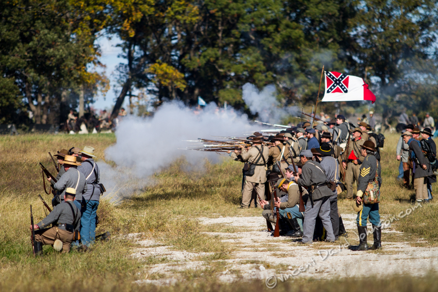 VINCENT D. JOHNSON - For Shaw Media Confederate reenactors fire upon their fellow reenactors on the Union side, Oct. 17, 2015. The battle reenactment took place at Dollinger Family Farm.