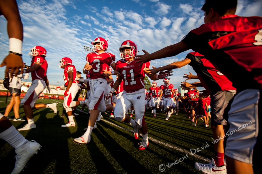 Hinsdale Central quarterback Josh Bean (3) and linbacker Brian McCarty (11), run onto the field through a tunnel of local youth football players, Friday, August 26, 2016, in Hinsdale. (Vincent D. Johnson-Pioneer Press).