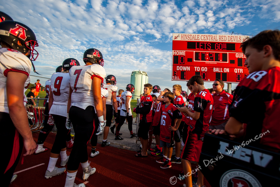 Hinsdale youth football players look at the players from American Fork like they were from another planet, Friday, August 26, 2016, in Hinsdale. (Vincent D. Johnson-Pioneer Press).