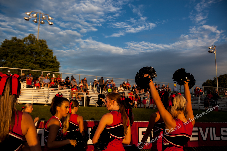 Cheerleaders from American Fork High School in Utah, practice some moves and talk before their very far away game at Hinsdale Central, Friday, August 26, 2016, in Hinsdale. (Vincent D. Johnson-Pioneer Press).