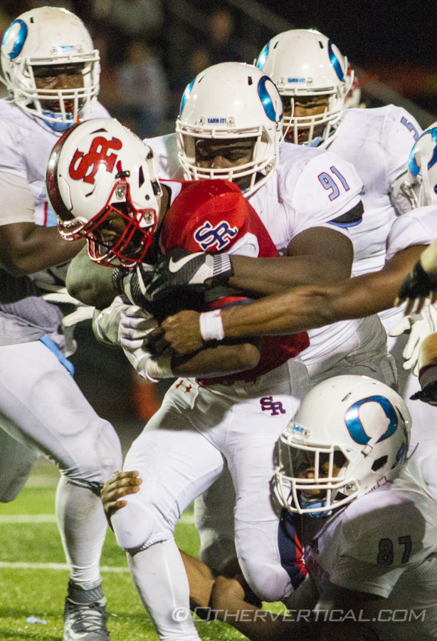 It took three Rich Central defenders to take down St. Rita's Shaun Rule (4) on this run in the second half, Friday, Sep. 2, 2016 in Chicago. (Vincent D. Johnson-Daily Southtown).