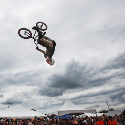 Jody Donnelly, of the Ride -n- Grind Stunt team did a back flip over a ramp on his BMX bike . Donnelly & his teammates were part of a mid day show inbetween bands during the 6th annual Iron Horse Roundup motorcycle show hosted by Austin's restaurant. The event was held in  the parking lot of the Libertyville Sports Complex. Vincent D. Johnson/for Sun-Times Media. Sunday, May 2nd 2010.