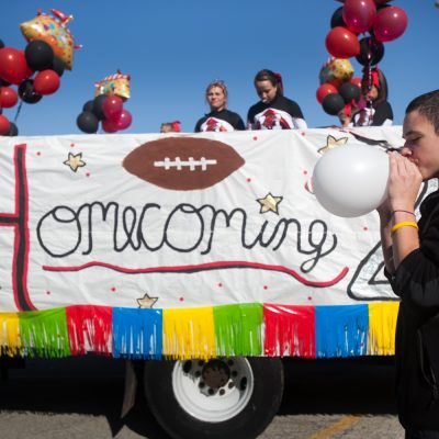 Park Ridge, 09/17/11-- Freshman  Matt Kelly, blows up a ballon for one of the Maine South Homecoming parade vehicles. Vincent D. Johnson~for Sun-Times Media