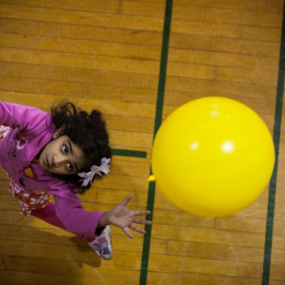 "Prisha Sherdiwala, 5, of Oak Park, tries to keep an inflated balloon off the ground and in a circle, in a game called the ""Balloon Valley Challenge"". Prisha, was one of dozens of kids taking part in the YMCA Healthy Kids Day at the West Cook YMCA in Oak Park. Vincent D. Johnson~for Sun-Times Media."