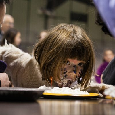 Oak Park, 10/26/12--Loretta Rosenthal, 5, of Oak Park, checks out the competition mid action and dad Sam, (left) coaches her on during the pumpkin pie-eating contest at the Hruby Ice Arena. | Vincent D. Johnson~for Sun Times Media