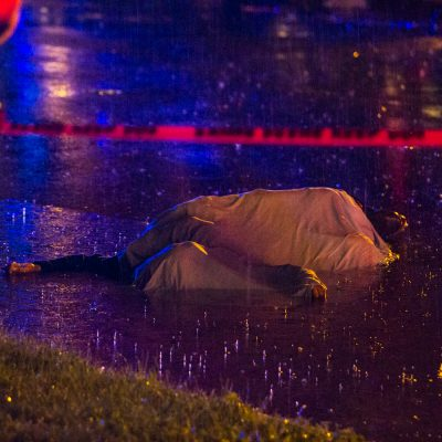 Chicago, 6/30/14--A 17 year old boy was shot and killed in the street on the 600 block of east 50th place Sunday night during the height of the storm. He clung to the last bit of life partially submerged in the gutter of the flooded one way street. | Vincent D. Johnson