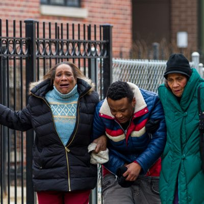 Possible friends or family members of grieve on a sidewalk in the 600 east block of 50th street after learning who the victims of a Valentines Day double murder were, February 14th, 2016, Photo by Vincent David Johnson.