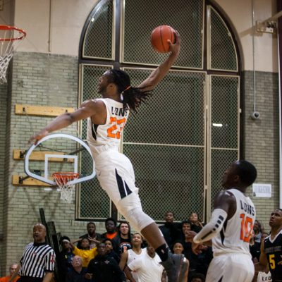 Leo's Dachaun Anderson on a break-away dunk against Dunbar, Friday, March 1, 2019, in Chicago. (Vincent D. Johnson-Daily Southtown).