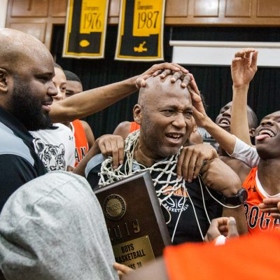 Bogan's head coach Arthur Goodwin gets a new necklace and a some love from his players after the Bengals won the class 3A St. Laurence Sectional championships 85-78 over Morgan Park, Friday, March 8, 2019, in Burbank. (Vincent D. Johnson-Daily Southtown).