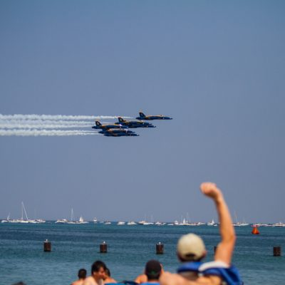Chicago, 8/16/15--A man pumps his fist in the air as the Navy Blue Angels pass by the crowd in formation during the 2015 Chicago Air & Water Show at North Avenue Beach. | Vincent D. Johnson/for Sun-Times Media