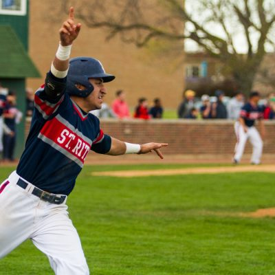 St. Rita's Esteban Martinez, starts to celebrate as his hit drove in the game-winning run in the bottom of the 7th inning to beat Providence, Wednesday April 29, 2015 in Chicago.  (Vincent D. Johnson/For the Southtown Star).