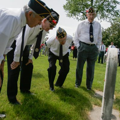 "Larry Smith, (L to R), Claus Christensen, Tony Longhing & Bob Weber, try to make out the names and dates on a set of grave stoens in Deerfield Cemetary during the Memorial Day celebration & parade in Deerfield. Names of soliders from Deerfield who fought or died in wars as far back ""The War of 1812"" & ""The Blackhawk War"" were read aloud during a rembrance speech in the cemetary.(5/28/07) Vincent D. Johnson photo/ for Pioneer Press."